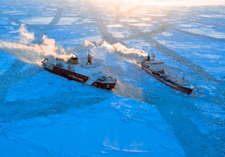 "The Coast Guard Cutter ""USCGC Healy"", the USCG's newest and most technologically advanced polar icebreaker, escorts a ship through Arctic Sea ice."