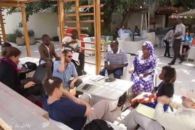 Participants in the 2-day Ebola workshop in Senegal enjoy a relaxed, small-group discussion. Photo credit: Michael Washington
