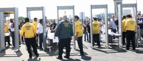 Three professional sports leagues (NFL, MLB and NHL) have mandated the use of walk-through metal detectors (also known as magnetometers) to enhance security at sports stadiums and arenas they oversee. Seen here are WTMDs in use by the Oakland Raiders. Photo credit: Oakland Raiders.