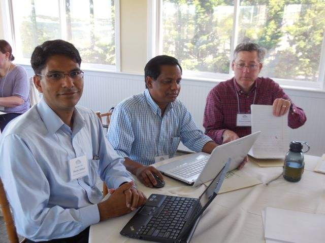 Participants in the 2014 RECONNECT program compare notes. From left: Dr. Dhruba Adhikari, Bellarmine University; Dr. M.A. Karim, Southern Polytechnic State University; and Dr. Michael Ackerman, Bellarmine University
