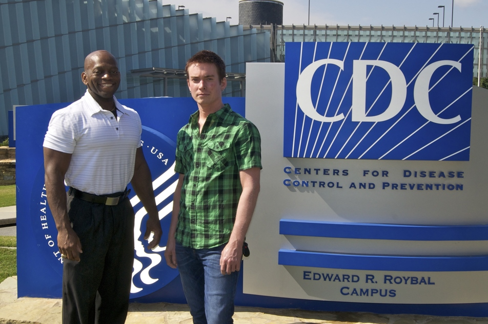 Former CCICADA graduate fellow Brad Greening (right) is seen here at CDC in headquarters in Atlanta with Dr. Michael Washington.
