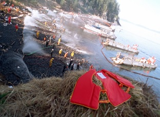 "A dramatic photo of cleanup operations following the massive oil spill caused by the 1989 grounding of the ""Exxon Valdez"" tanker in the Gulf of Alaska."